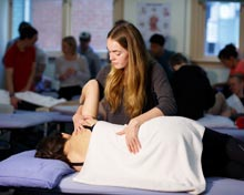 Osteopathy student in clinic with patient