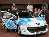 Marketing staff with the Peugeot 308 wagon