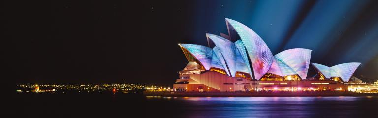 Sydney Opera House (at night); photo by Ethan Ou