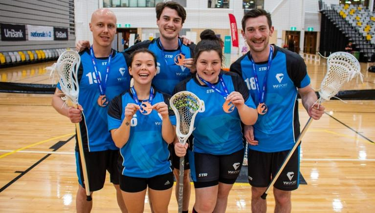 Unisport Nationals Lacrosse team hold medals