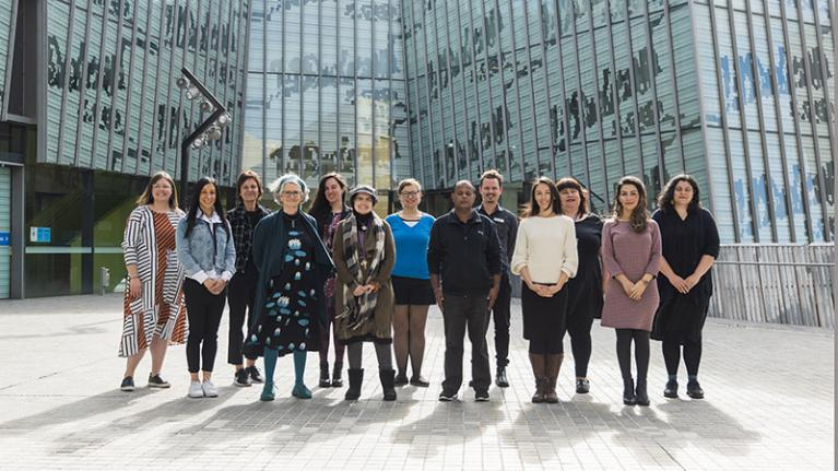 Group of learning hub advisors pose in outside the VU library