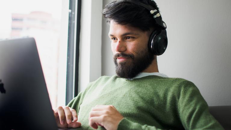 bearded man working on laptop