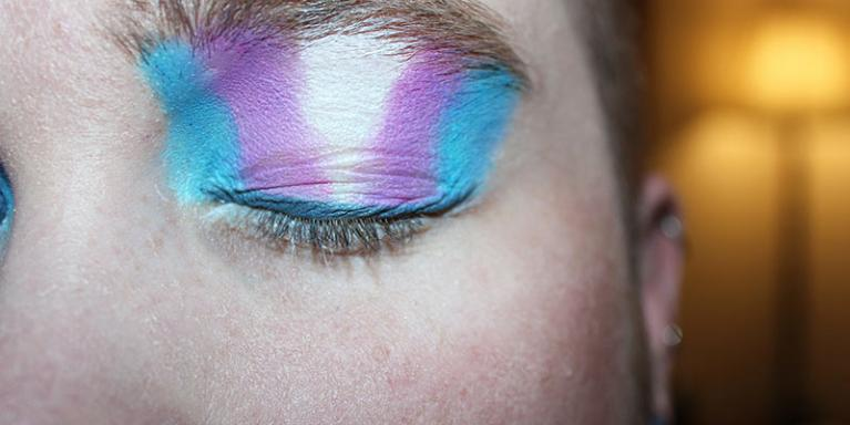 People with the colours of the transgender flag on their eyelid.