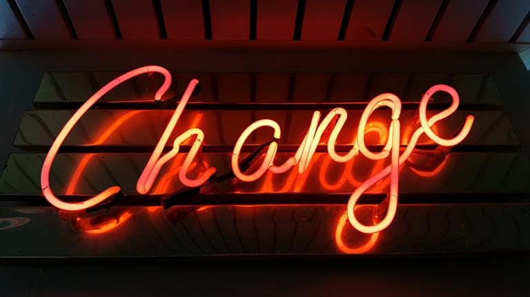 neon sign of the word change