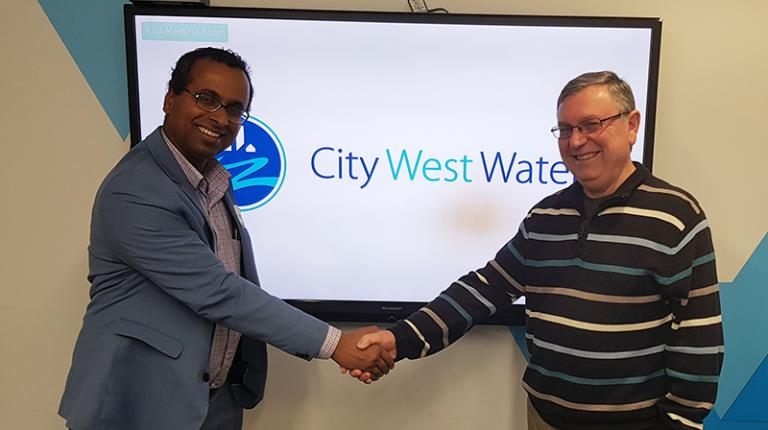 VU researcher shake hands with City West Water