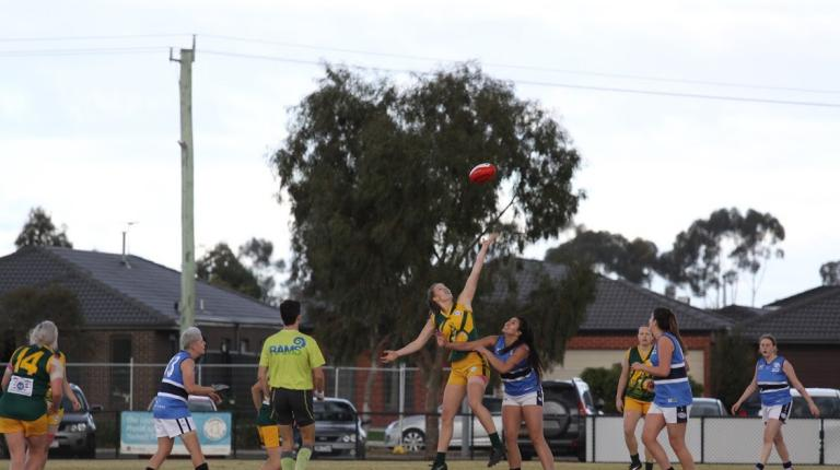 Female AFL players, mid-game